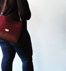woman wearing chelsea shoulder bag