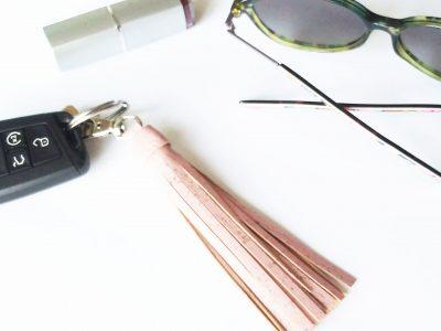 pink glitter vegan leather bag charm tassel